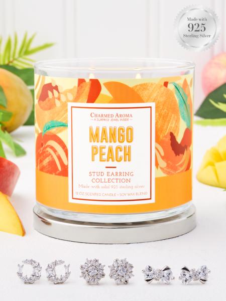 Charmed Aroma - Duftkerze mit Schmuck - Duftkerze im Glas Mango Peach (Ohrring)